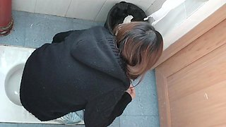 Women pissing in a public bathroom caught on spy cams