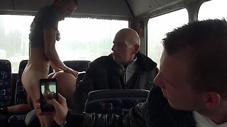 A blonde is getting fucked hard in the bus while people are looking
