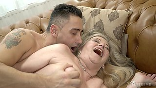 GILF Betsy drops by and fucks a young man with love