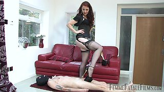 The high heels and black costume turns on horny Mistress Lady Renee