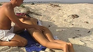 Viktoria in a really hot couple fucking on a sandy beach