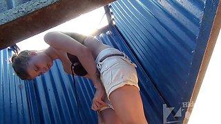 Hidden cam filmed tiny body in the beach cabin