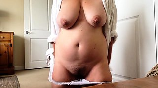 Curvy mature lady exposes her big tits and rubs her snatch