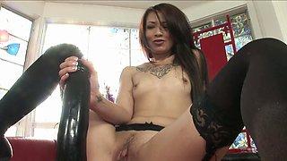 A brunette that loves her huge dildo is jacking off nicely