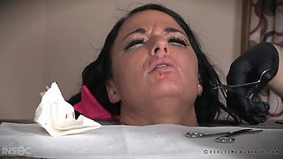 pretty brunette getting her lips stitched together