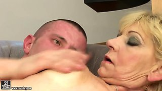 Curvy granny Irene with hairy cunt rides a young and strong dick