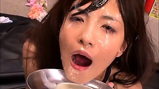 Nasty Asian babe has a group of guys unloading on her face