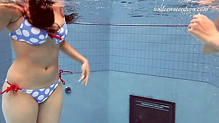Two saucy honeys Iva and Paulinka strip down in the pool