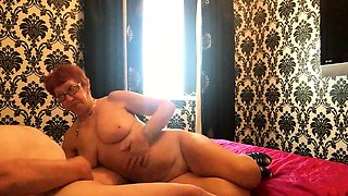Big breasted redhead granny with glasses loves to suck cock