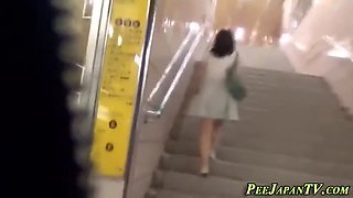 asian lady pees in toilet