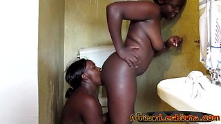 Couple of young chubby lesbians from Africa make love in bathroom
