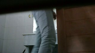 Peeing spy cam shot of a cute asian girl on a toilet