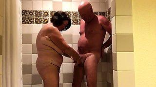 Curvy mature wife reveals her handjob skills in the shower