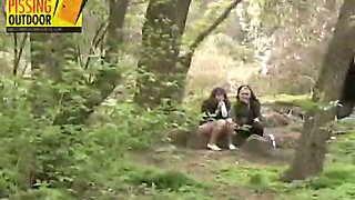 Two nasty bitches pee in the forest after smoking cigarettes