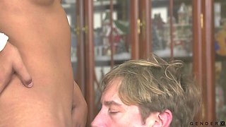 Submissive dude stands on knees to give shemale Mara Nova a blowjob