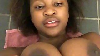 Hot African Teen Shows Tits in Bathroom