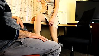 Charming brunette in pantyhose shows off her footjob talents