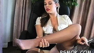 Dirty slut pleasing her stud while smoking a cigarette