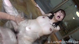 Charming Asian pornstar with big tits gets fucked doggy style in the pool