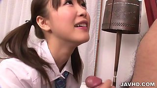 Pretty school girl Momoka Rin examines and sucks a dick