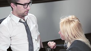 Blonde secretary in stockings helps boss to relax in the office