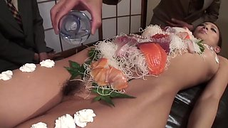 Group Of Business Men Eat Sushi Off Her Beautiful Body