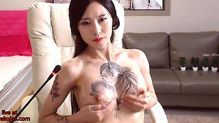 Korean babe with amazing tits masturbates