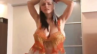 Busty arab whore gets horny stripping