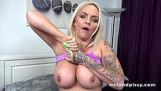 Piss loving UK MILF with big soft boobs is masturbating with her dildo