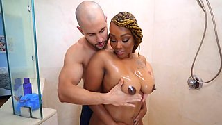 Bald boy relaxes in the bathroom together with curvy black diva