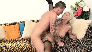 Tattooed busty granny gets fucked by a young guy