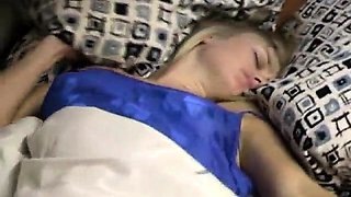 Sleeping blonde teen has a kinky guy caressing her pussy