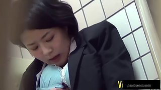 A kinky asian schoolgirl will be caught while masturbating within a public toilet