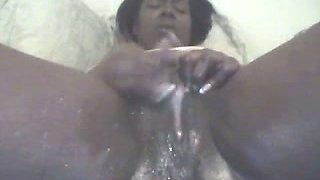 Ugly black webcam slut rubs her clit and tickles pussy madly