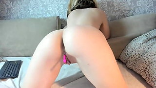 Busty girl with dildo in pussy