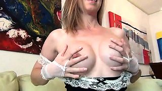Provocative blonde maid with big hooters milks her nipples