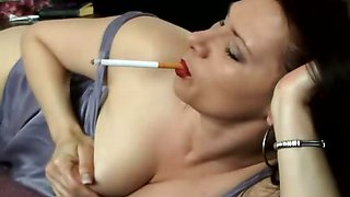 Brunette whore smoking while fingering her pussy