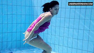 Cute Zlata Oduvanchik swims in a pink top and undresses