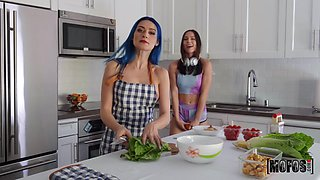 Two housewives are cooking and making love right on the kitchen table
