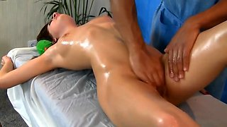 Oiled up brunette chick gets a nasty massage treatment