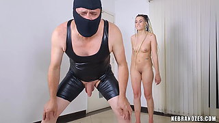 Tall Amazon Mistress explodes his testicles for fun