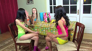 Three amazing chicks in colorful clothes having fun on the floor