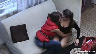 Ravishing lesbian babes getting kinky on the couch