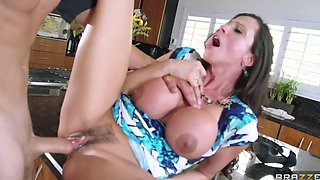 The phenomenal cougar has big round juggs and big sex hunger